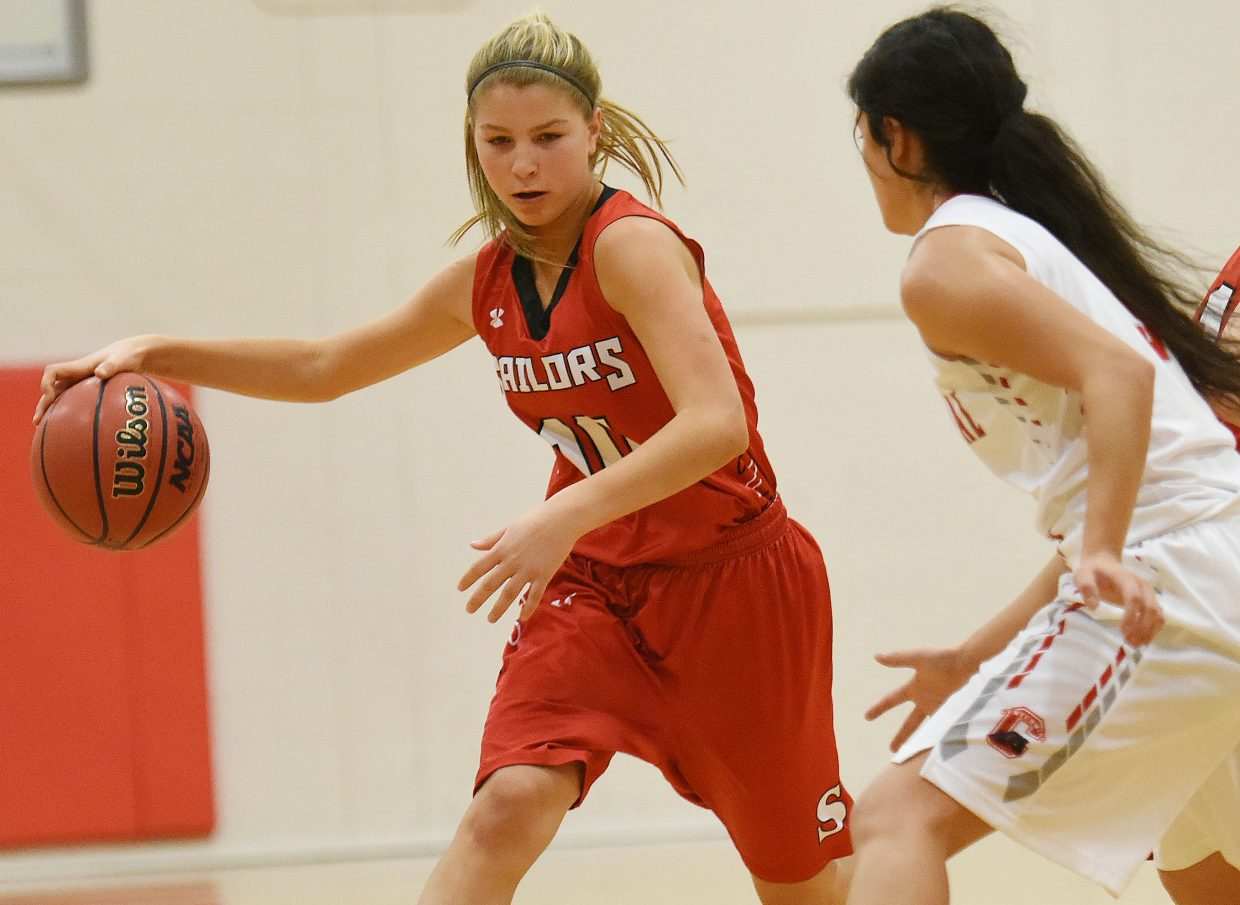 Steamboat's Izzy Rillos pushes up the floor Saturday against Pueblo Centennial.