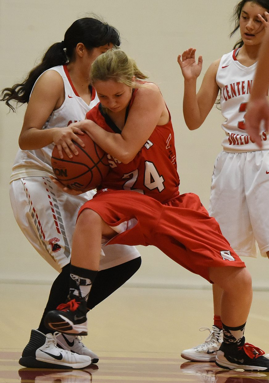 Steamboat's Jaycee May tries to hang on to the ball Saturday as the Sailors playing Pueblo Centennial in the Steamboat Shoot-Out.