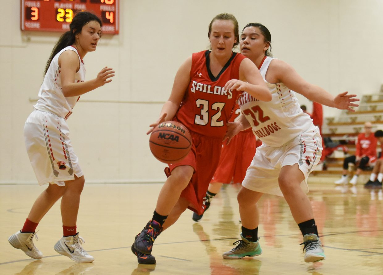 Steamboat's Shelbee Weiss dribbles between defenders Saturday at the Steamboat Shoot-Out.