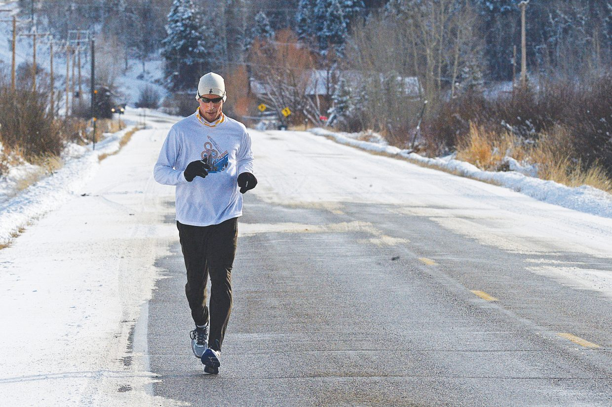 Steamboat Springs' Nate Anderson didn't let the snowy roads keep him from heading out to Strawberry Park on his daily run Wednesday afternoon.