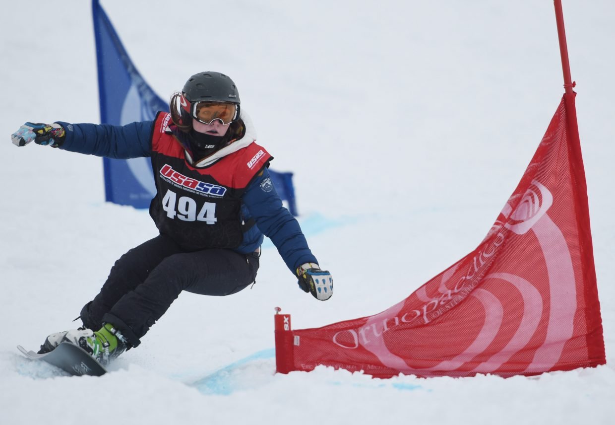 Maggie Rose Carrigan cuts around a gate during a 2016 USASA snowboarding event at Howelsen Hill in Steamboat Springs. She went in to win in her division in both the slalom and giant slalom races.