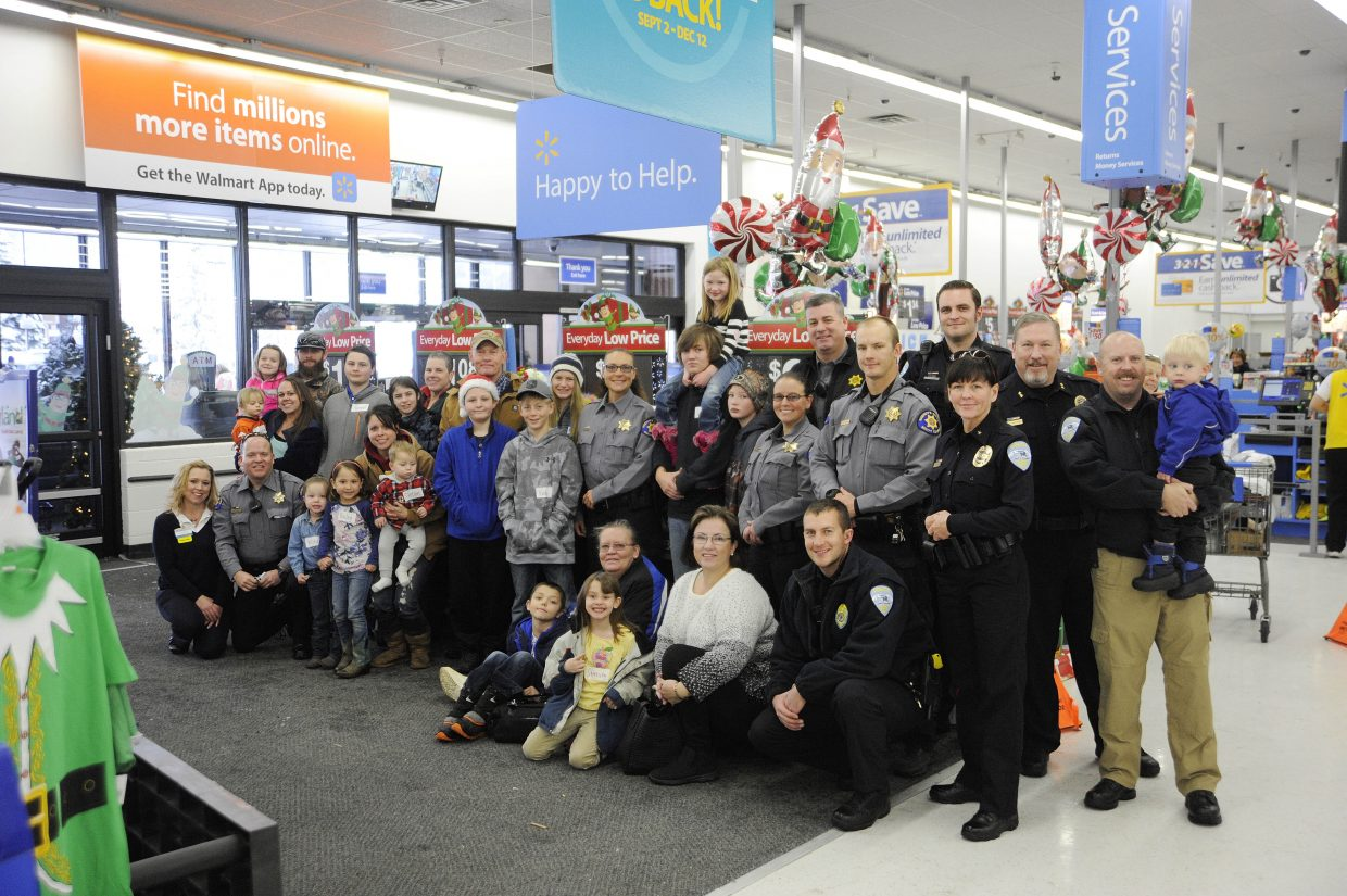 18 local youth shopped with Routt County Sheriff's Office deputies and Steamboat Springs Police Department officers during Shop With a Cop on Sunday at Walmart.