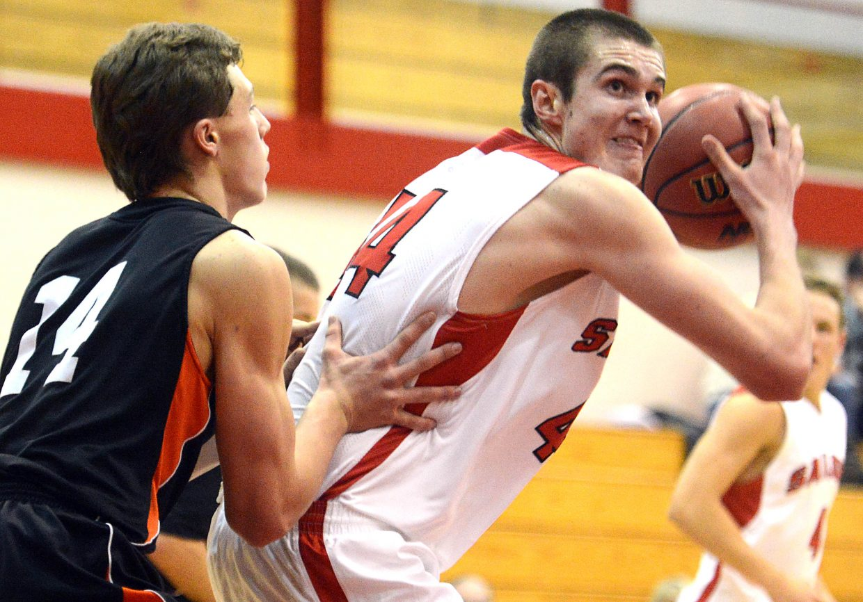 Steamboat's Garrett Bye spins toward the hoops Thursday at the Steamboat Springs Shoot-Out.