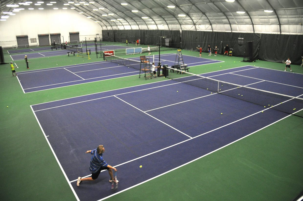 Youth tennis players play Thursday night at the Tennis Center of Steamboat Springs. With new staff members and a growth in the youth tennis program, the center has had an eventful year.
