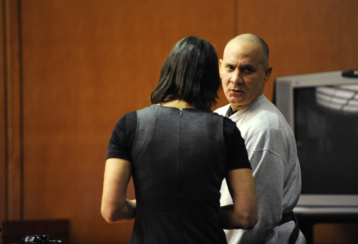 Steven Torres speaks to Public Defender Sheryl Uhlmann after he was sentenced Thursday to four years in prison.