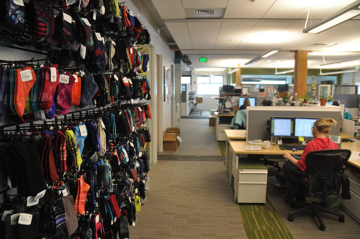 Socks line a wall of SmartWool's newly renovated corporate headquarters in Steamboat Springs. The city is working to resolve an issue with jet fuel odors that are making it into the building from the runway outside.