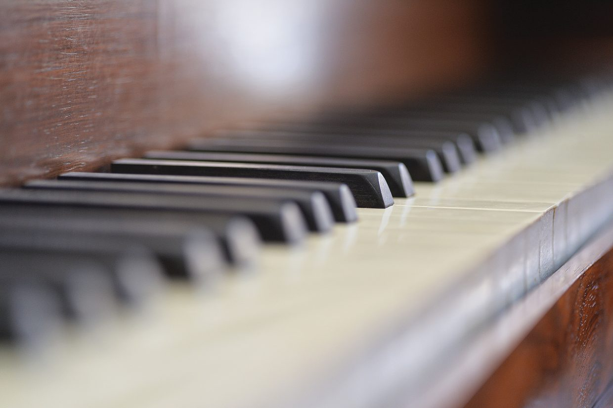 The keyboard of an antique piano inside the Victorian bed and breakfast.
