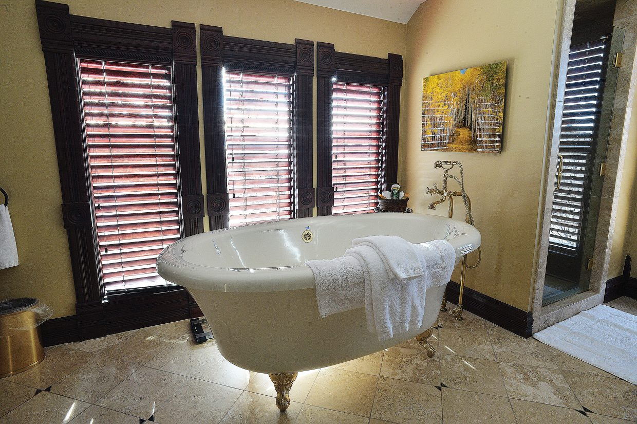 One of the bathrooms inside the Victorian features a classic bear-claw bathtub. The house, which was brought to Steamboat Springs from Kansas in five pieces, got a lot of attention when it was relocated underneath the gondola a few years ago. Last week, the owners opened their doors to the community to see what's inside.