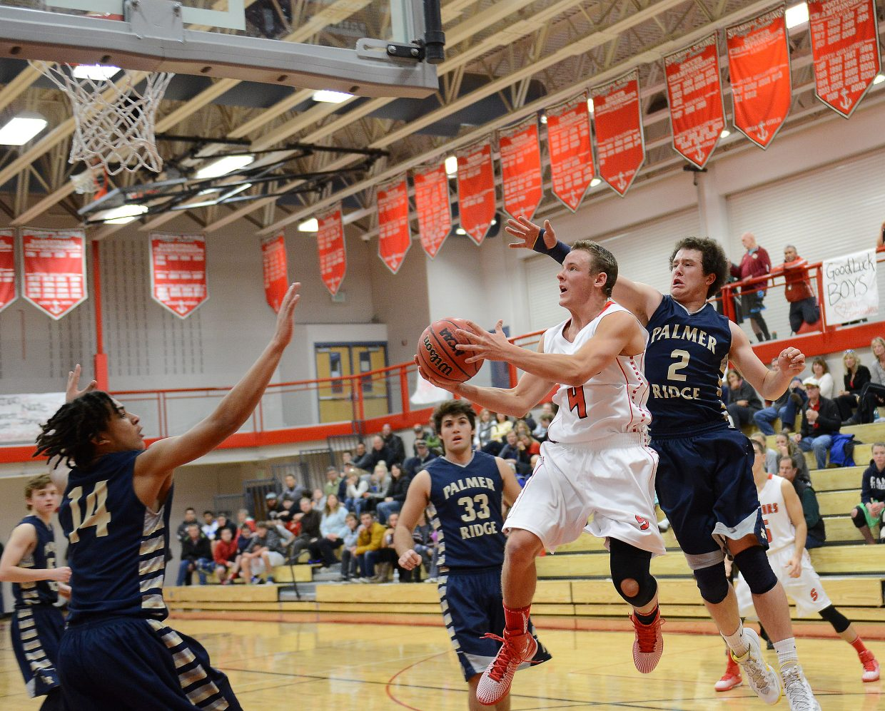 Mitch McCannon drives the baseline Saturday against Palmer Ridge. He scored and drew a foul on the play, helping Steamboat pull close in the game.