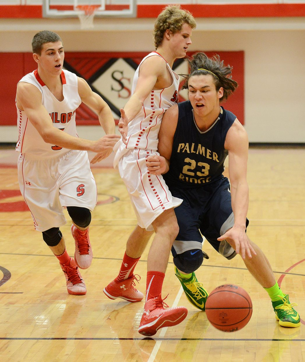 Palmer Ridge's Matt Cameron drives into the lane Saturday against Steamboat during the Steamboat Shoot-Out.