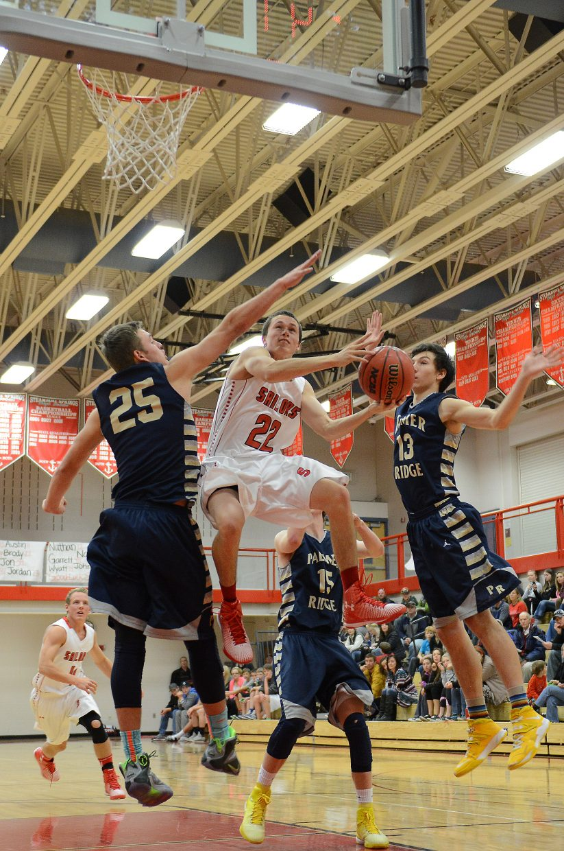 Brody King tries to get a shot up in the lane Saturday.
