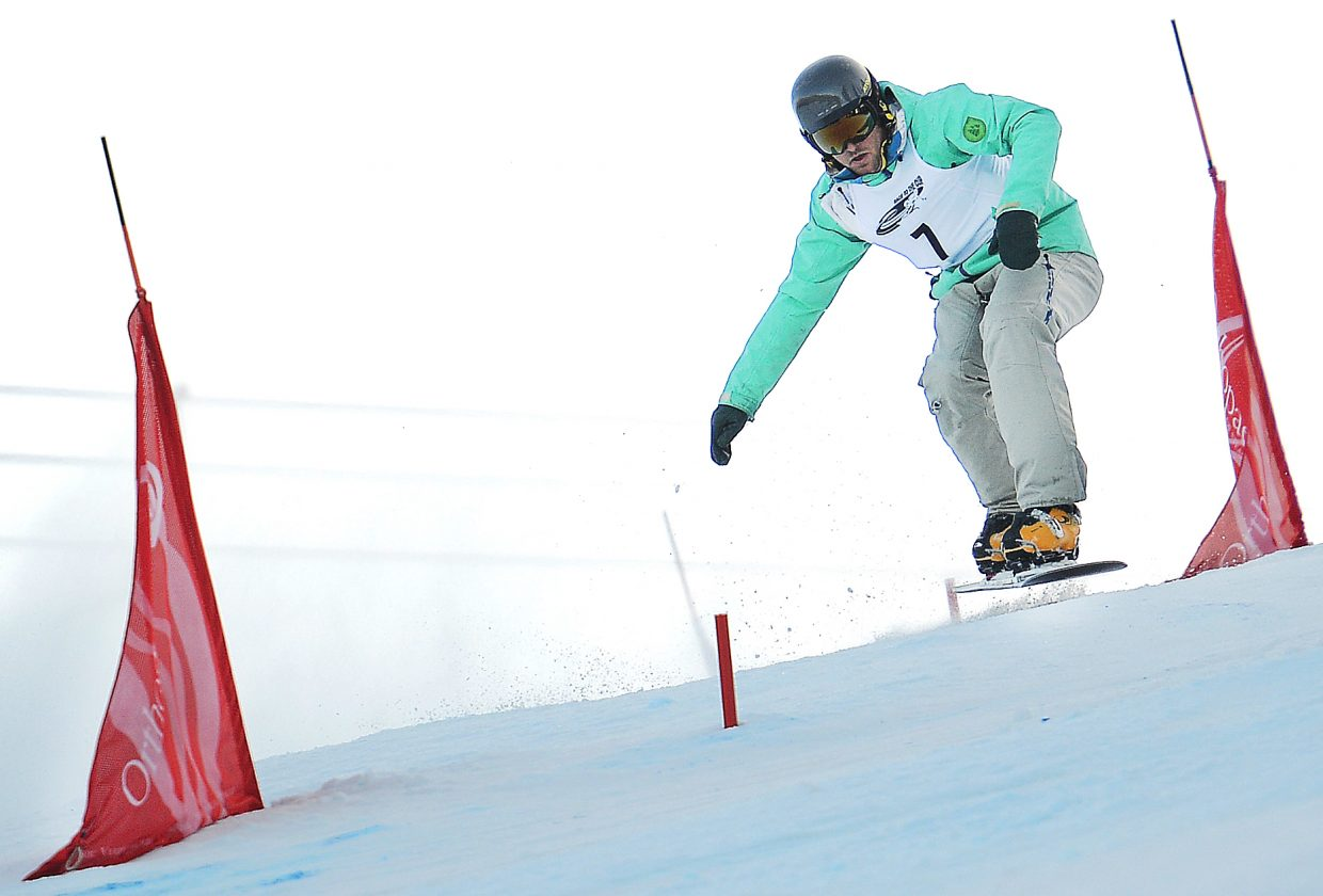 Steamboat Springs snowboarder Converse Fields flies between the gates Saturday during the Race to the Cup parallel slalom event at Howelsen Hill. Fields owned the event, his first Nor-Am victory.