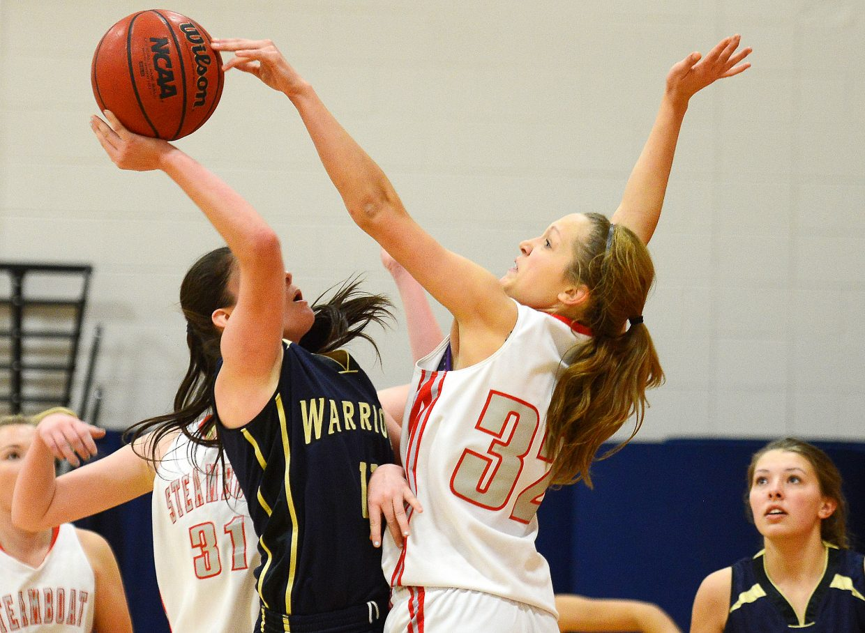 Steamboat's Maddison Clock reaches for a big block on Frederick senior Alex Dufour on Saturday. The Sailors trailed big early but bounced back big to win the game, their first win of the three-game Steamboat Shoot-Out tournament.