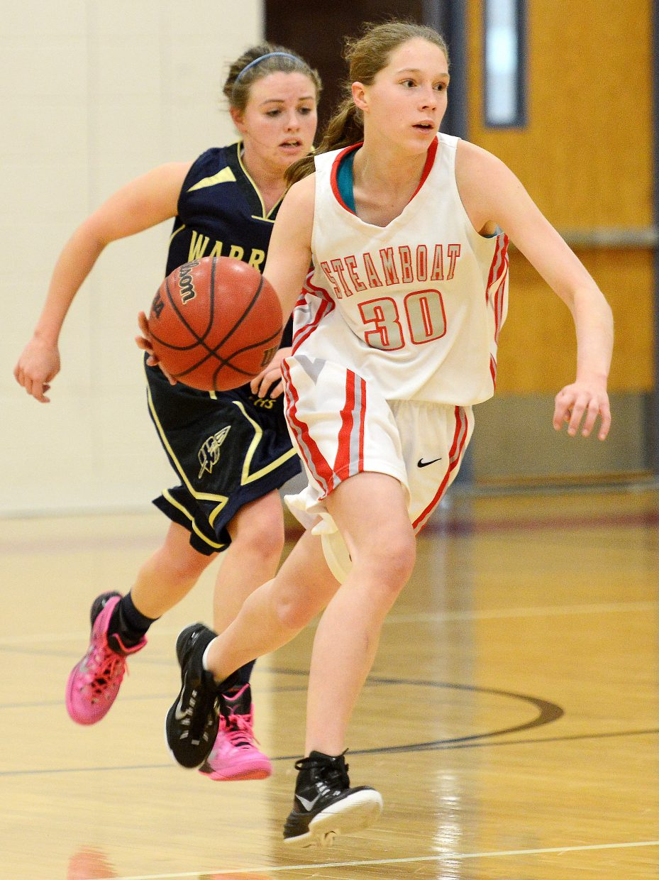 Steamboat's Allison Casey drives down the floor Saturday.