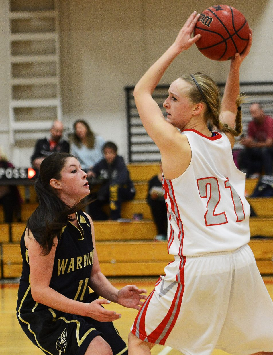 Steamboat's Kady Look tries to pass the ball down the floor Saturday.