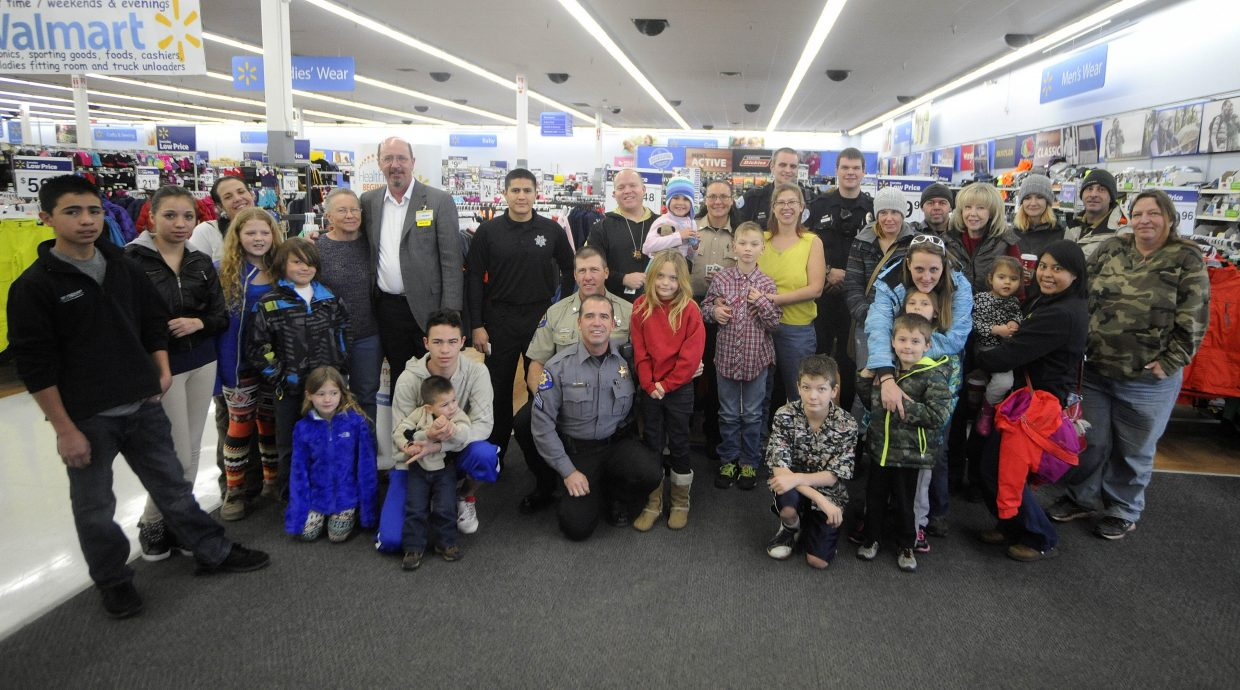Local law enforcement officers helped 14 Routt County youths shop for presents during Shop With a Cop on Saturday at Walmart.
