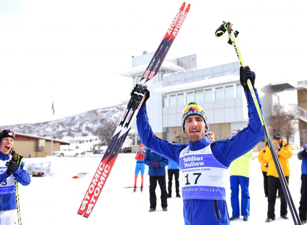 Taylor Fletcher celebrates after winning Sunday's Continental Cup Nordic combined race at Solider Hollow, Utah. Fletcher started the race 17th, but worked his way up to win in a sprint to the finish.