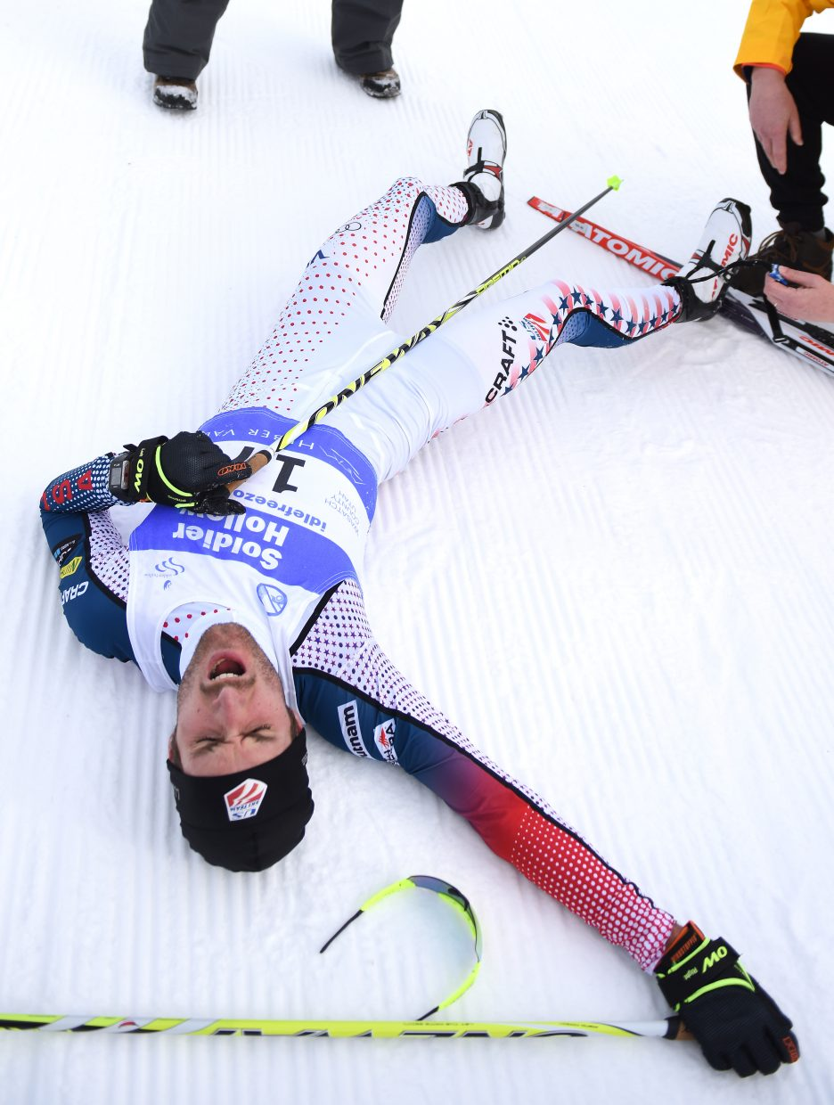 Taylor Fletcher lays exhausted after squeaking out a win in Sunday's Continental Cup Nordic combined race at Solider Hollow, Utah.