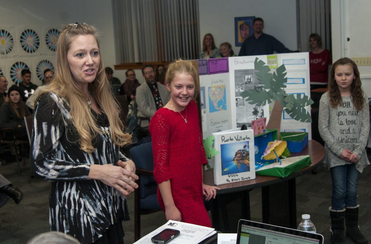 "Sunset Elementary School Principal Jill Hafey follows up presentations by Sunset students Alexis Jones and Megan Neton to the school board Monday night. Jones shared her project about planning a trip to Puerto Vallarta, and Neton shared her project about creating a ""native backyard"" incorporating Native American elements. The two were part of Sunset's first round of Envision projects, which encourages student initiative."