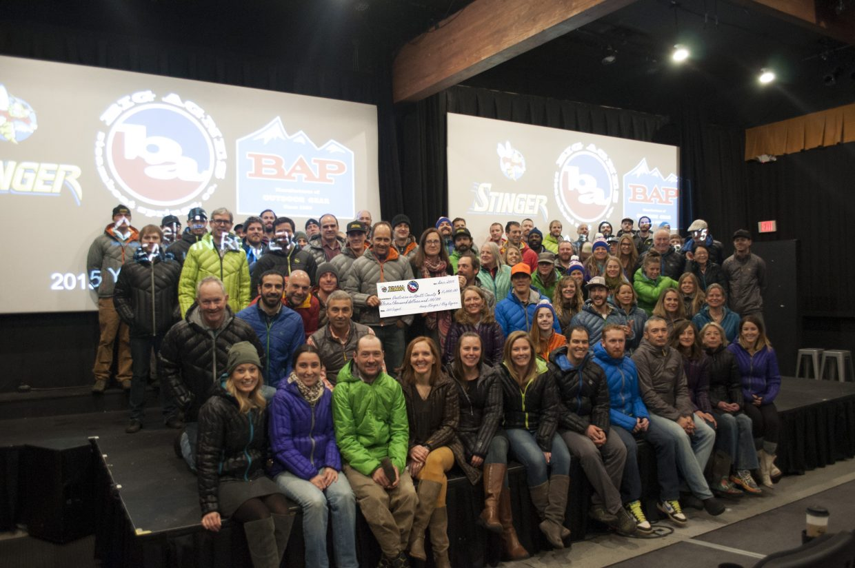 Bill Gamber, along with employees from BAP, Big Agnes and Honey Stinger, present a check to Michelle Petix and Becky Slamal from Partners in Routt County. A total of $5,700 was raised through an all-employee jacket fundraiser. The funds from every Big Agnes jacket purchased by an employee were donated to the nonprofit. An additional $5,300 was raised through the Steamboat Stinger race.