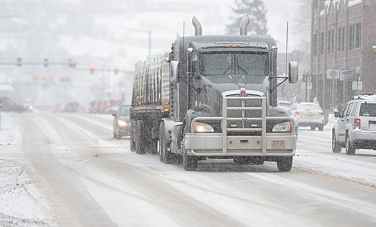 The snow returned Wednesday afternoon making driving conditions in downtown and the surrounding area tricky.