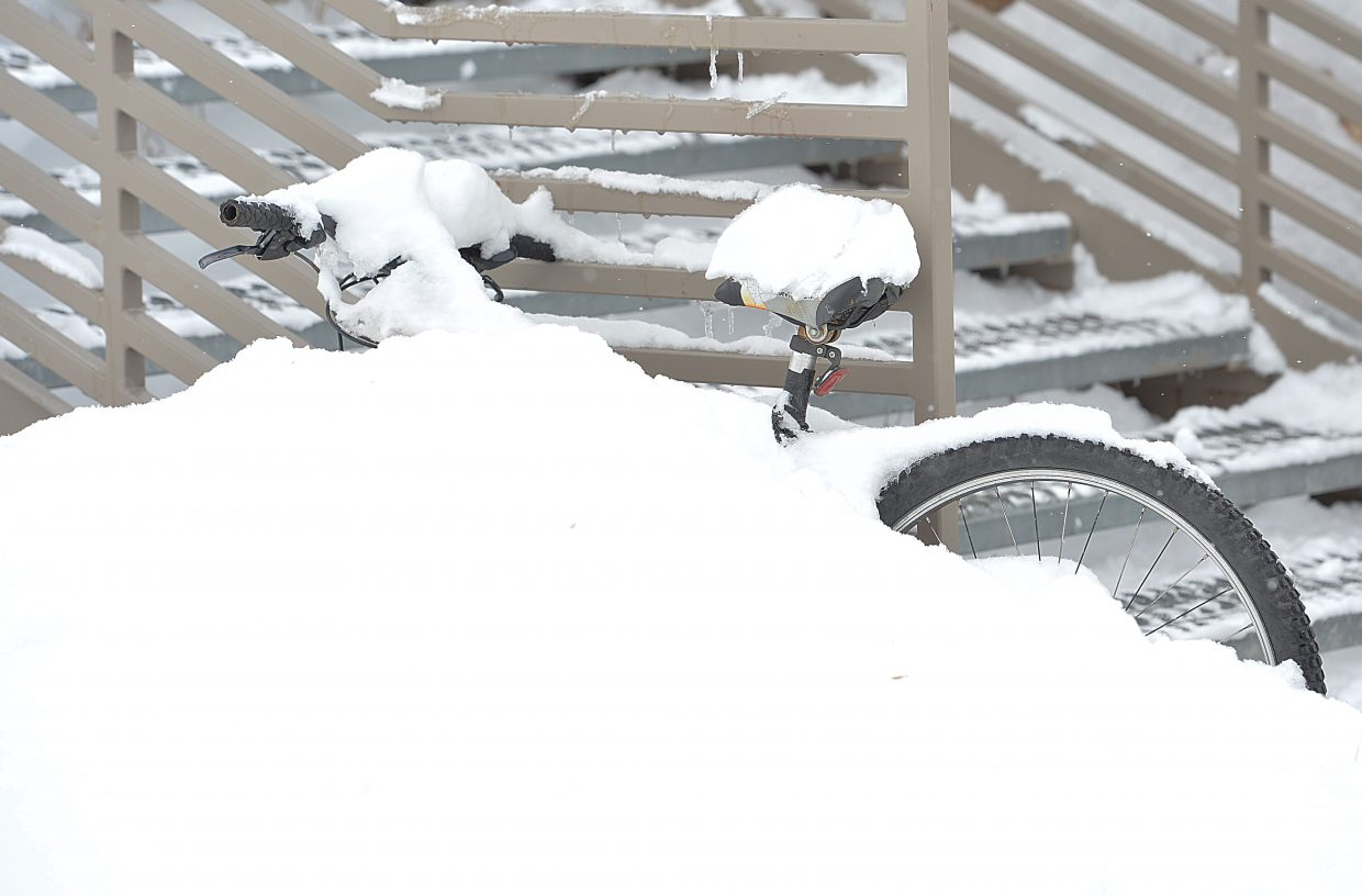 A bike is buried in snow Monday on the Colorado Mountain College Alpine campus in Steamboat Springs.