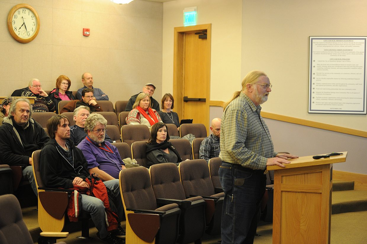 Community member Brian Berry asks the Steamboat Springs City Council on Tuesday night to release more information about the recent internal police investigation. Several other community members asked the council to reconsider its Dec. 1 vote not to seek a more thorough summary of the investigation.