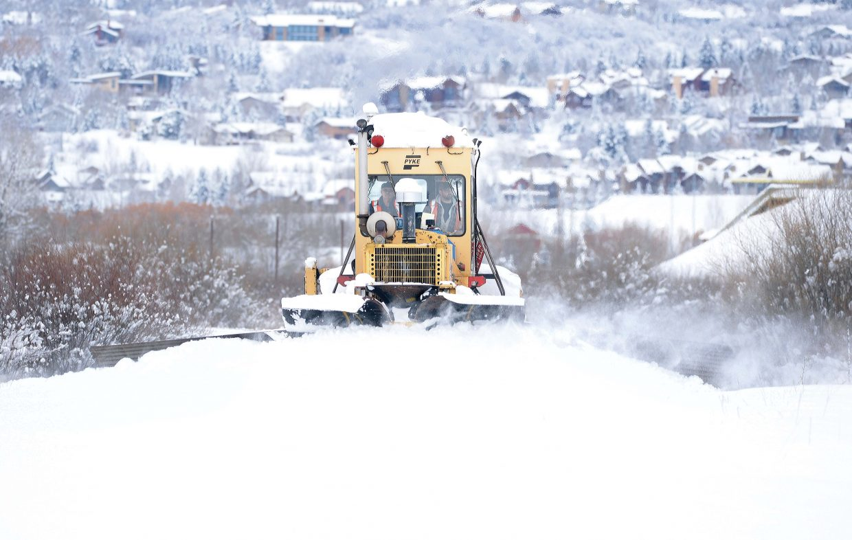 Crews from the Union Pacific clear the train tracks of snow just outside of Steamboat Springs Tuesday afternoon.