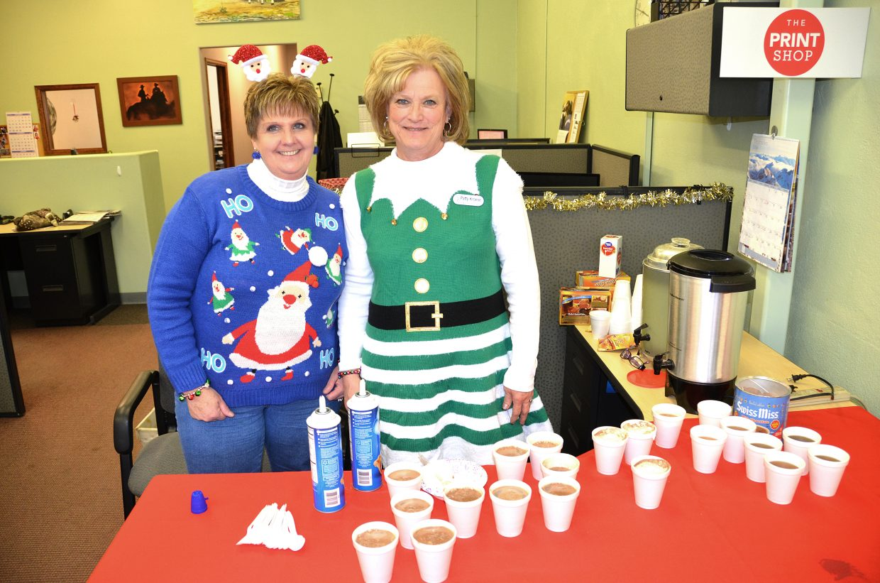 Kathy Watson, left, and Patty Kroese from Bank of Colorado pass out hot chocolate and goodies to children who participated in Letters to Santa at the Craig Daily Press Wednesday. Bank of Colorado is a sponsor of the annual event.