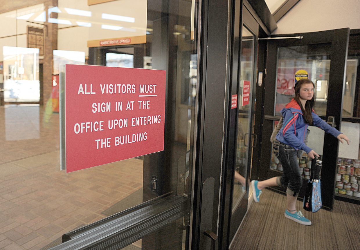 A student leaves the Steamboat Springs Middle School on Monday afternoon after classes. The school has adopted a strict security policy following the Columbine shootings. Visitors are buzzed into the building and are required to check in and the front desk, where they sign in and are issued a visitors pass.