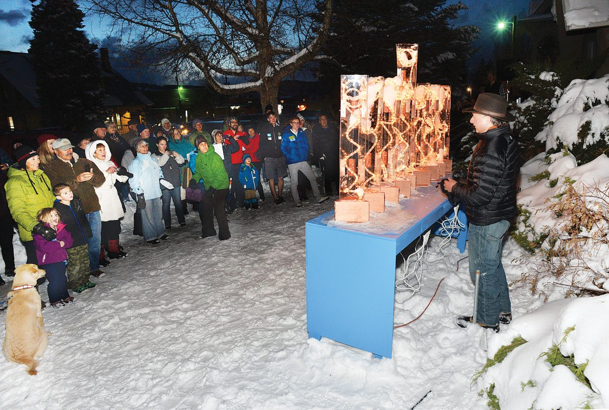 Randy Salky lights a decorative menorah Tuesday night on the lawn in front of the United Methodist Church of Steamboat Springs. The Methodist church and its board invited Har Mishpacha, the Jewish congregation of Steamboat, to place the decorative menorah on its lawn during the celebration of Hanukkah in Steamboat. Tuesday marked the first night of Hanukkah.