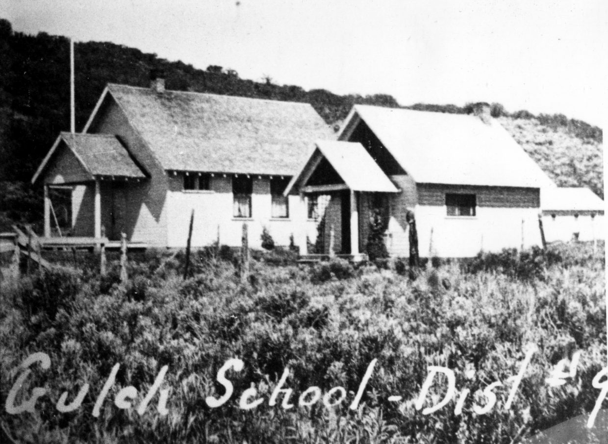 This is an old photo of the Fly Gulch School, a historic one-room schoolhouse.