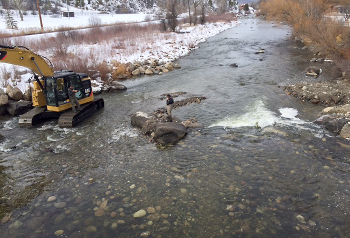 Gary Lacy of Recreation Engineers and Planning surveys the reconstructed Ambulance Hole in the Steamboat town stretch of the Yampa River. Nordic Excavating placed the boulders that separate the kayak play hole from a bypass (river left) that should help both trout and tubers.