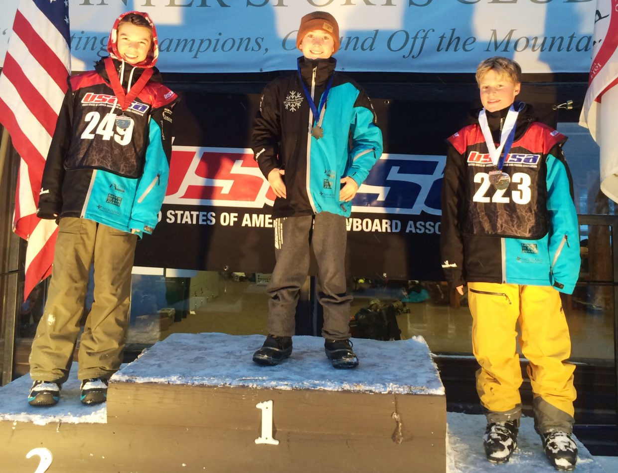 Steamboat snowboarder Marty Boyd, center, stands atop the podium for the breaker boys slalom race on Saturday after winning the USASA event at Howelsen Hill in Steamboat Springs. He's joined by a pair of teammates, Cooper Scheel, right, in second, and Jacy Werner in third. In the GS race Scheel won while Werner was second and Steamboat's John Duty third.