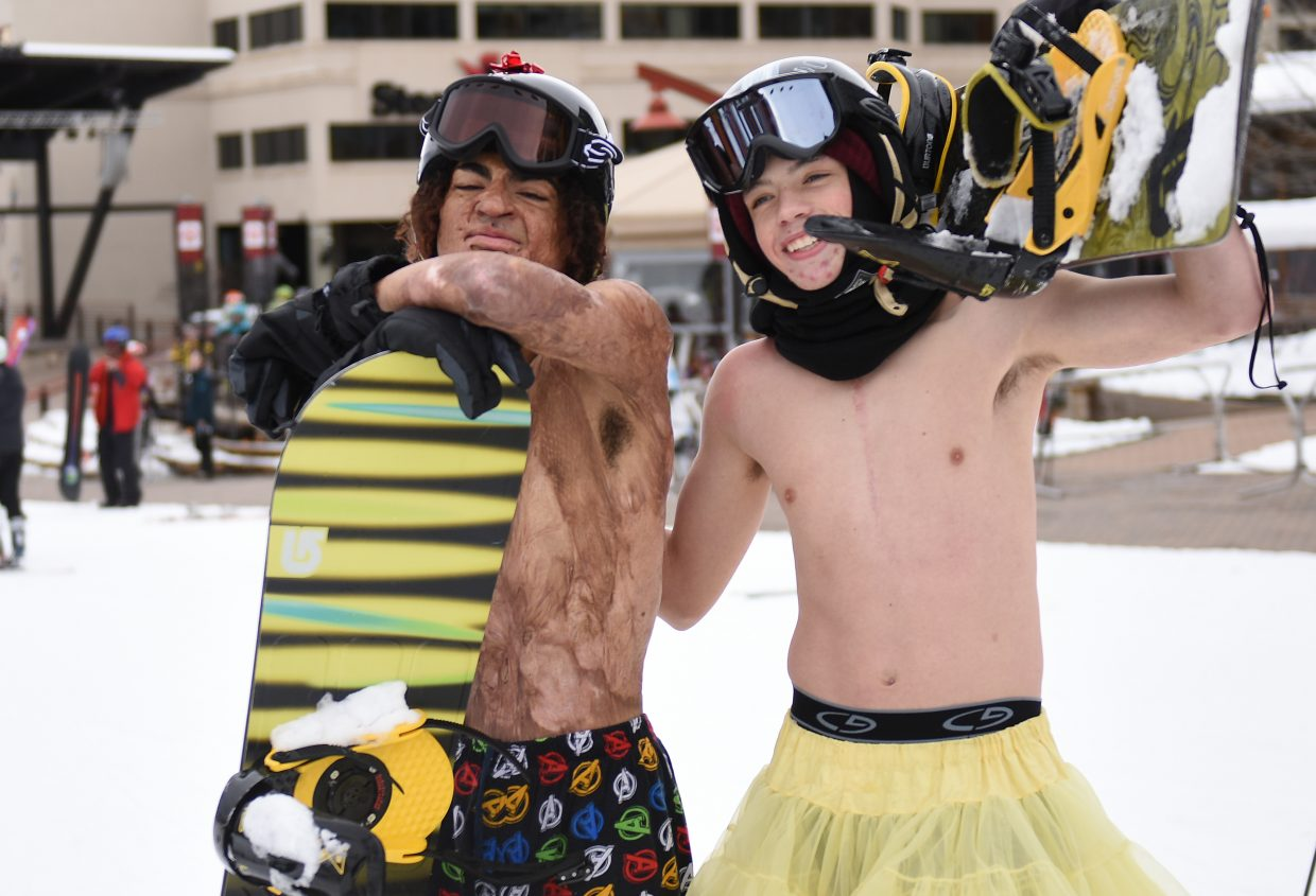 Dontrell Akashiya, left, and Zechariah Myrick gave up their shirts for a trip down the Preview run Thursday at Steamboat Ski Area during the Children's Hospital of Colorado children's burn camp. The pair said the camp has proven valuable as they've recovered from their injuries, allowing them to meet other teenagers going through similar situations.