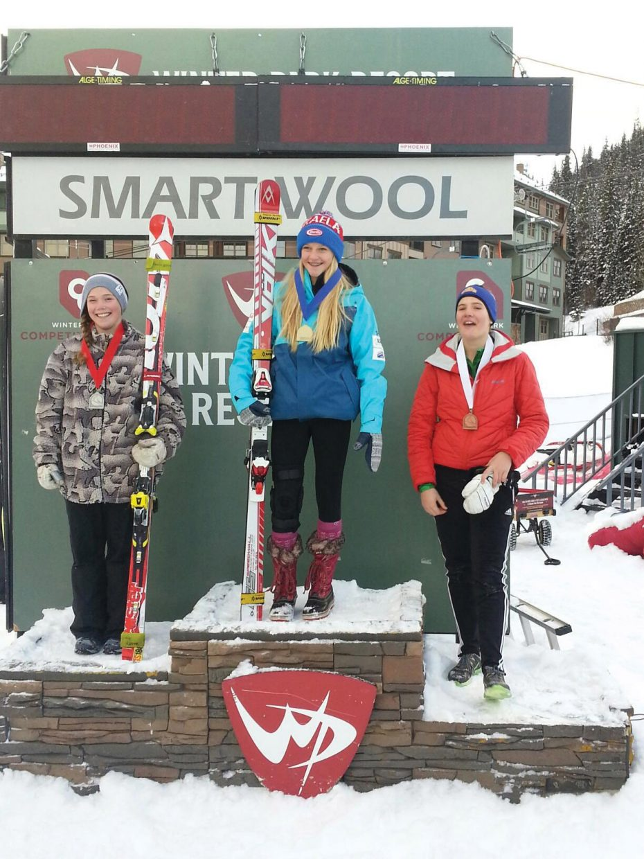 Winter Park ski racer Andrea Arnold topped the 16-and-under field at Saturday's SmartWool Ski Cup giant slalom in Winter Park. Steamboat's Logan Sankey, left, who finished second in the age group, and Jazlyn Lynch, right, who placed third, joined the Winter Park ski racer on the podium.