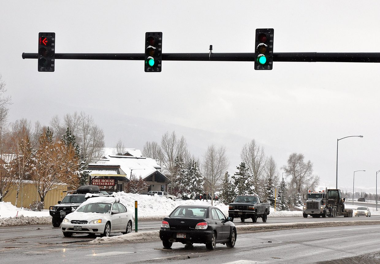 Traffic moves through the intersection of Pine Grove Road and U.S. Highway 40 on Wednesday afternoon. The traffic lights at the busy intersection were changed to improve pedestrian safety.