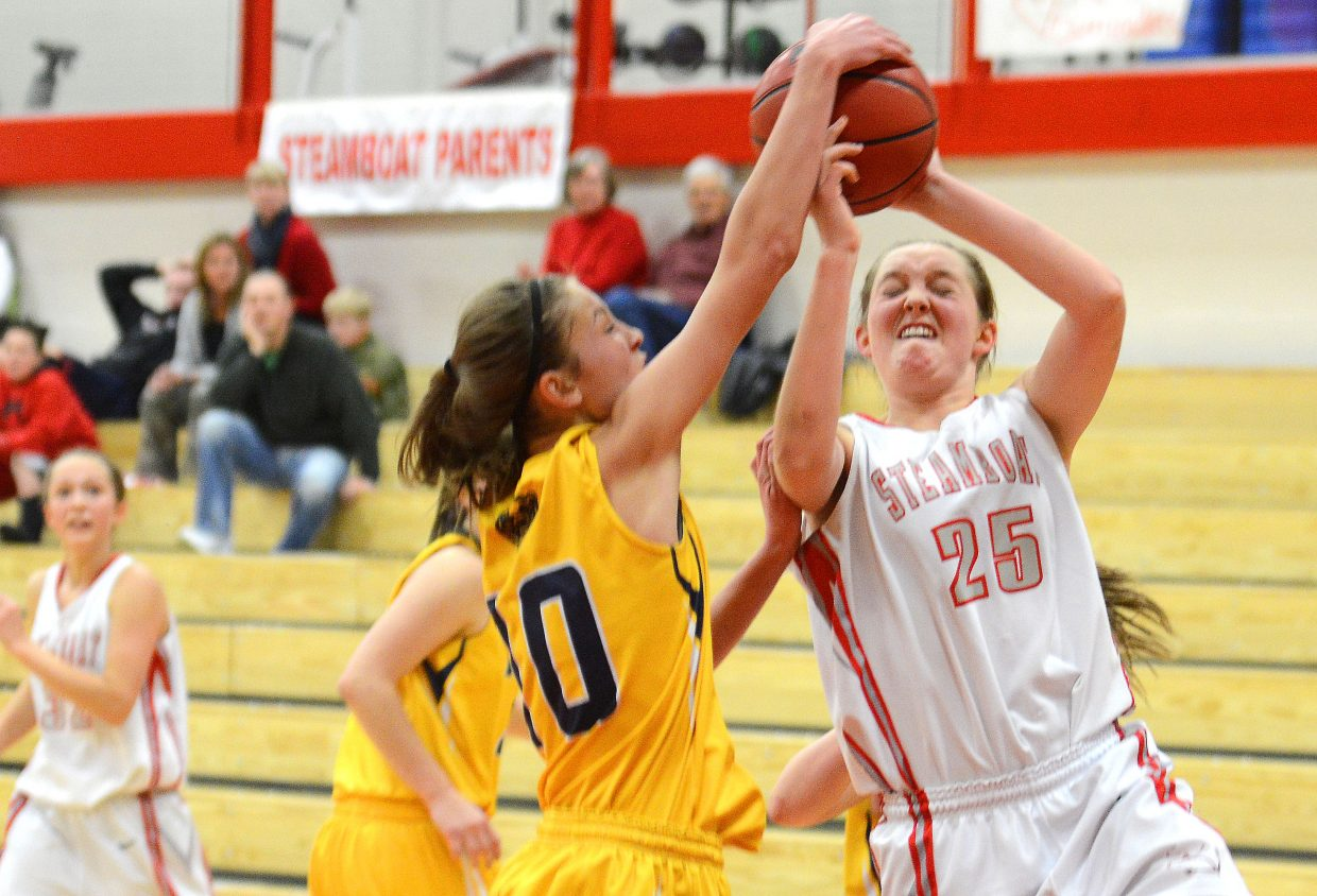 Steamboat's Jenna Miller has her shot blocked Wednesday against Rifle.