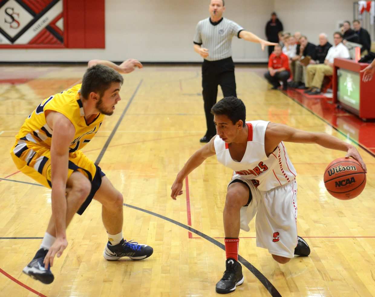 Steamboat's Hector Lopez tries to lay down a dribbling move Wednesday against Rifle.