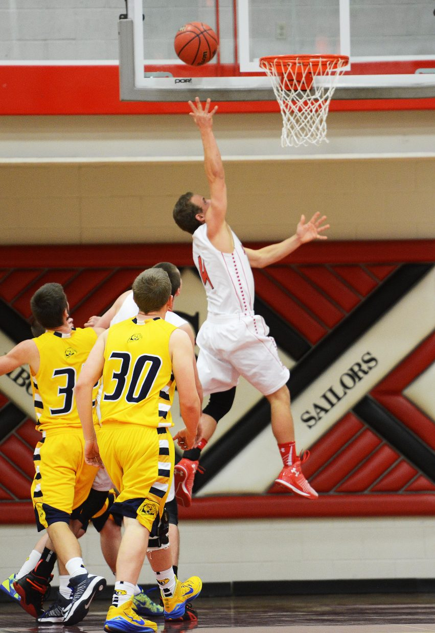 Steamboat's Mitch McCannon puts up a layup Wednesday against Rifle.
