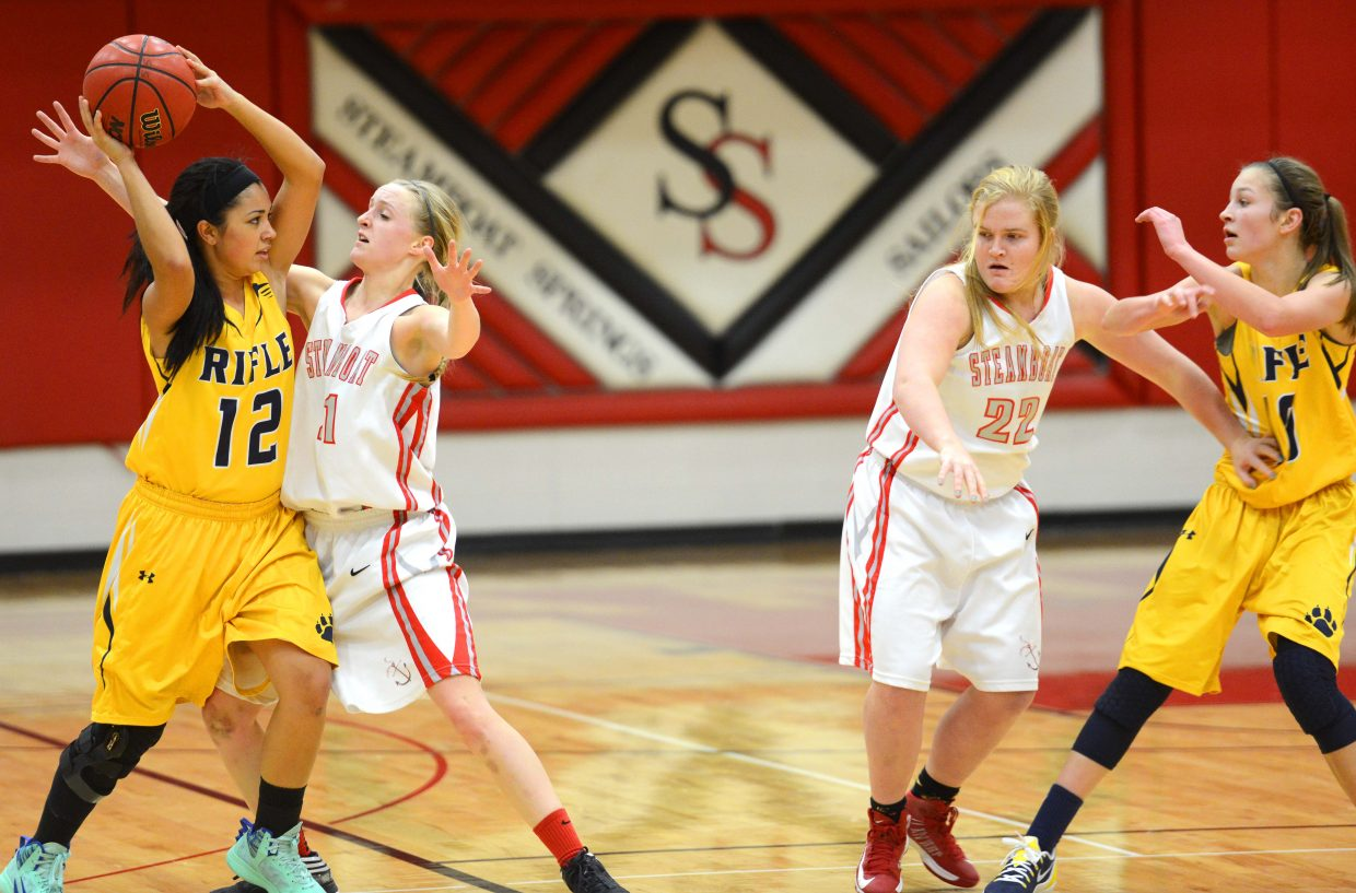 Steamboat's Kady Look, left, and Tess Richey lay on the defense Wednesday against Rifle.