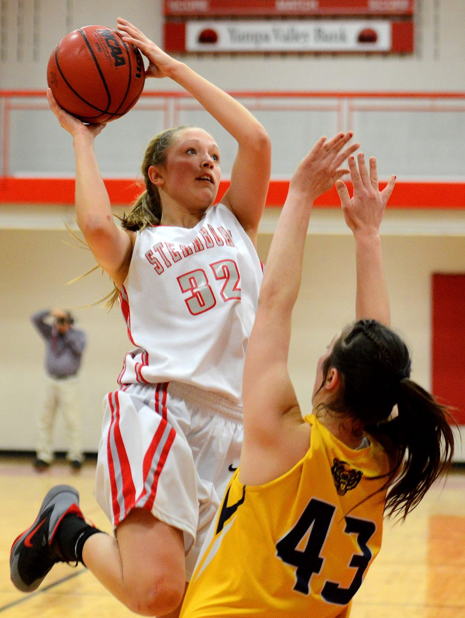 Steamboat's Maddison Clock drives for a basket Wednesday against Rifle.