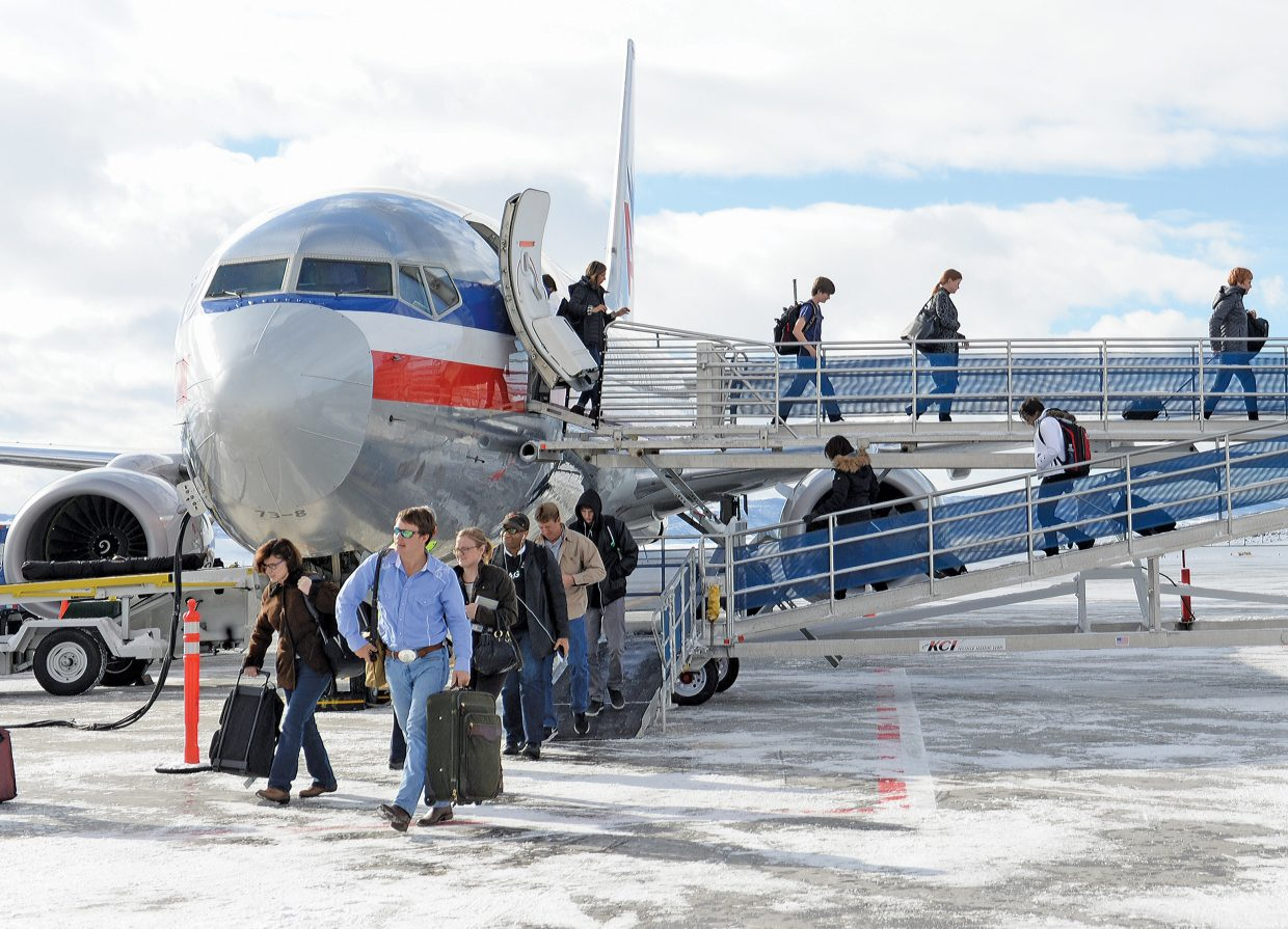 Passengers deplane an American Airlines flight from Houston at the Yampa Valley Regional Airport in Hayden on Thursday afternoon. The direct flight was one of several large planes that arrived after winter air service returned to the valley last weekend. Officials said this weekend will be some of airport's busiest days of the year.