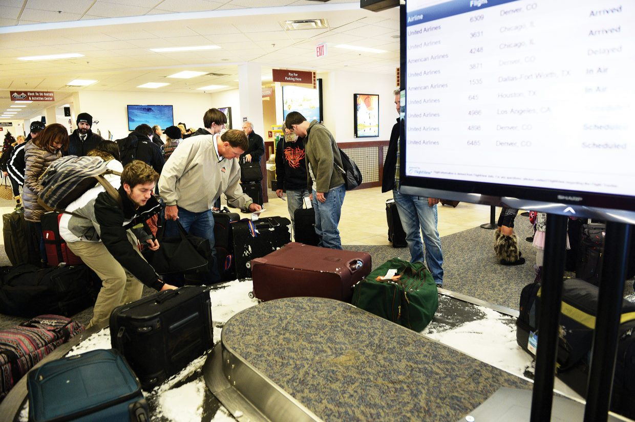Passengers pick up luggage after arriving at the Yampa Valley Regional Airport in Hayden Thursday. The airport is back in high gear after the winter flights began at the airport last weekend.