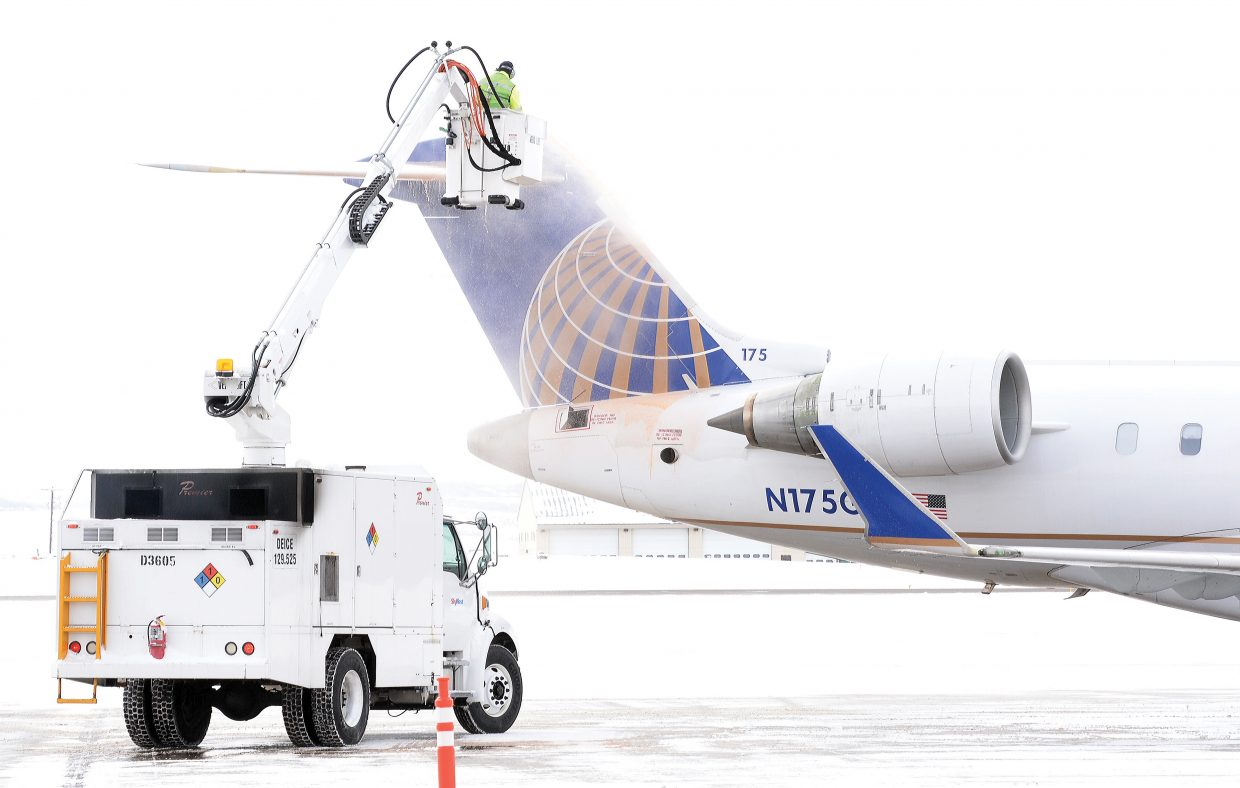 A member of the ground crew de-ices a United Airlines flight in the past at the Yampa Valley Regional Airport in Hayden. It takes diligence and hard work to keep the airport cleared and running during winter storms.