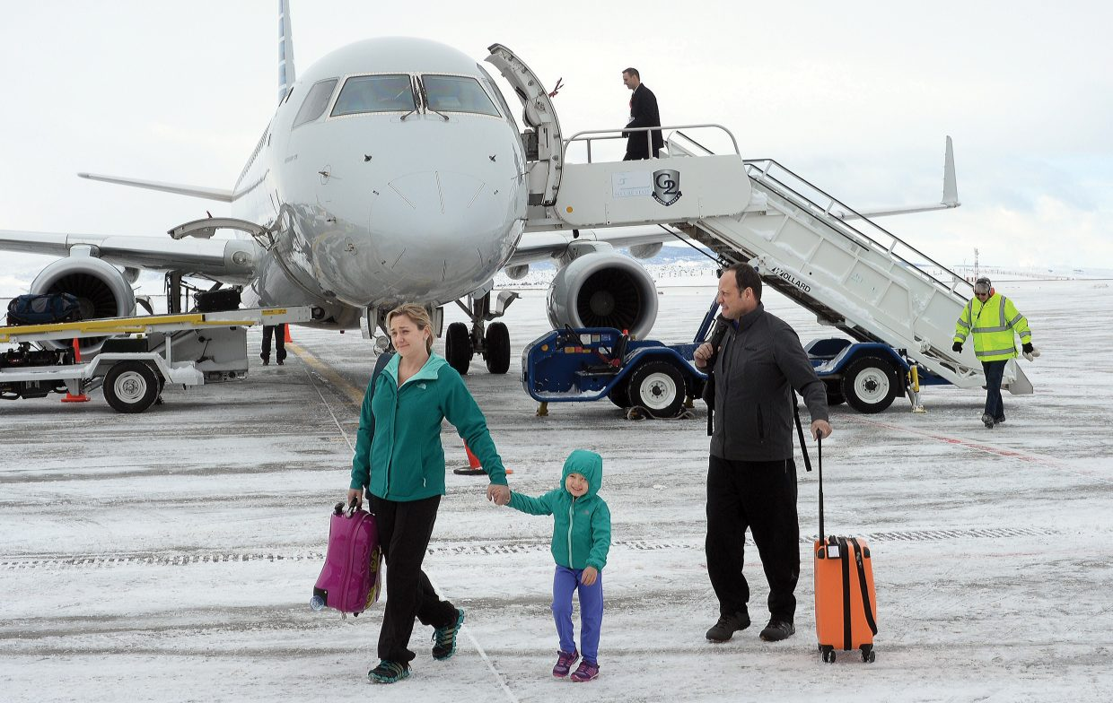 Hailey Rosenstein, her daughter, Jesslyn, and her husband, Michael, depart their flight after arriving at Yampa Valley Regional Airport on Thursday afternoon. The Rosensteins, from Chicago, traveled to Steamboat Springs for a holiday skiing vacation. Activity at the YVRA is in high gear after winter flight service started in December.