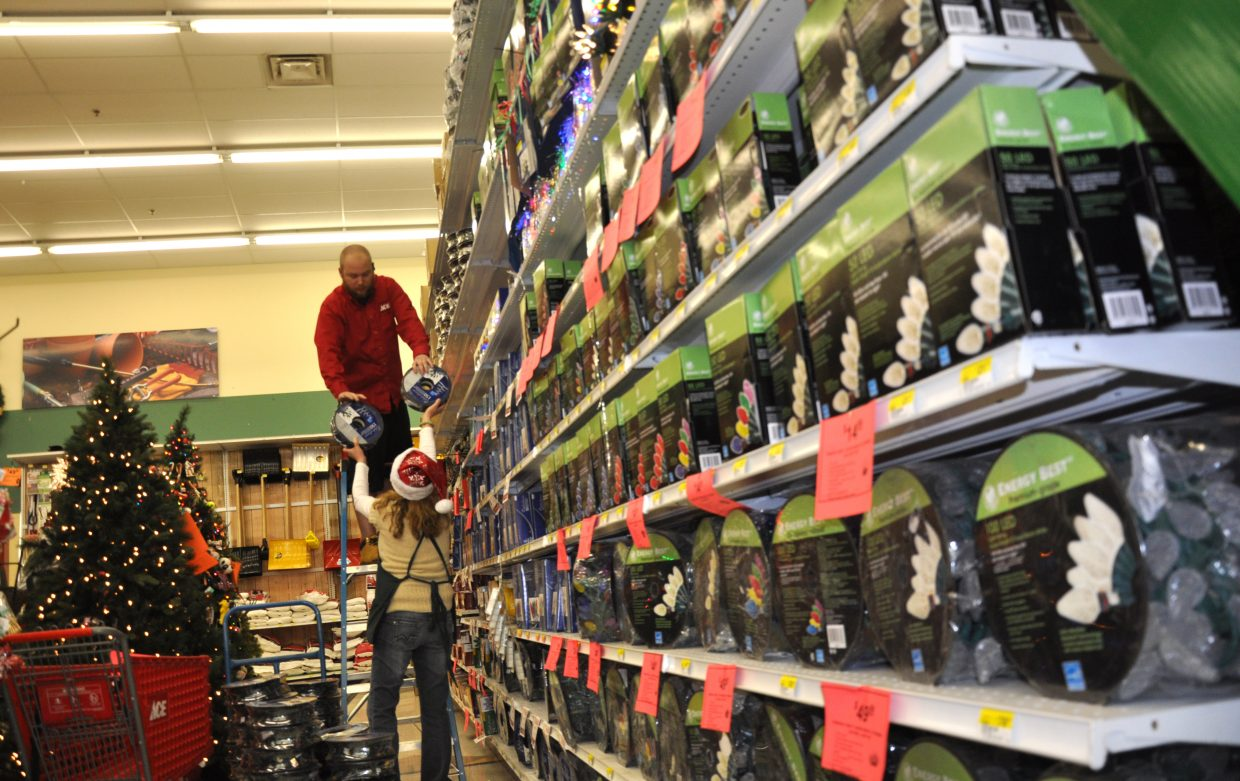 Ace at the Curve employees Kristin Schwab and Jeff Knox stock a large section of holiday lights on Wednesday afternoon. The city of Steamboat Springs is estimating 2013 sales tax revenue will come in at least $1.9 million over what the city projected in its budget.