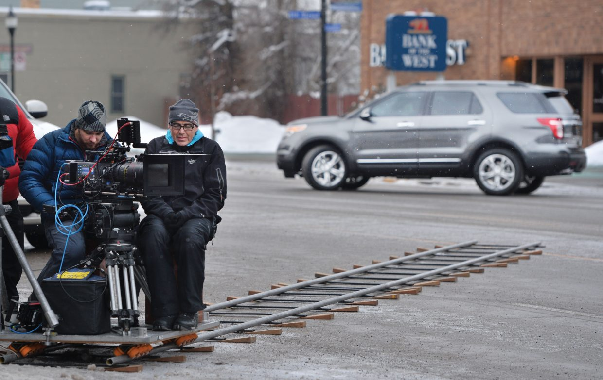 Cameraman Logan Schneider and Todd Boyle, first assistant cameraman, worked to shoot a Ford commercial in downtown Steamboat Springs Thursday morning. The production company Ranch Exit Media chose Steamboat for its small town feel, great snow and the fact that director Chris Patterson is a former resident of Steamboat Springs.