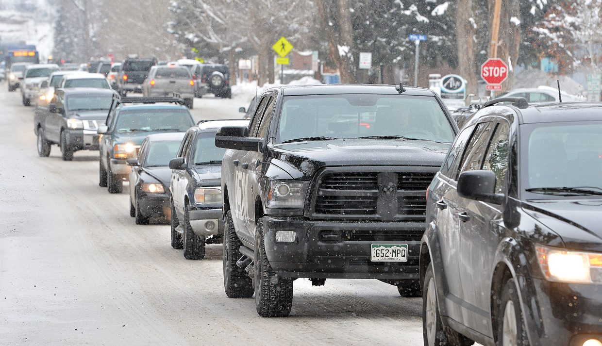 Traffic backs up along Oak Street Thursday morning due to the closure of Lincoln Avenue for a Ford commercial shoot.