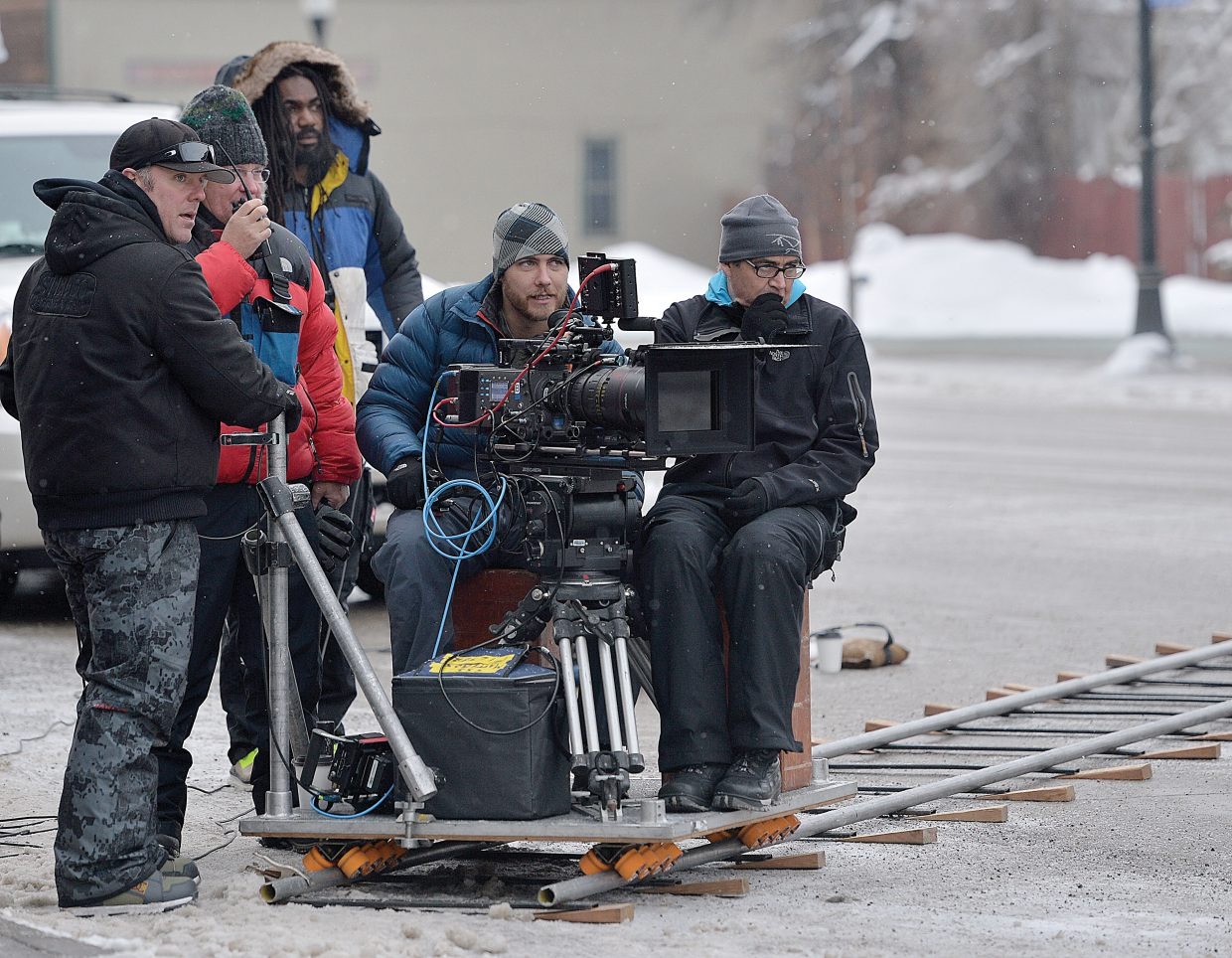 Cameraman Logan Schneider and a crew of others work to shoot a Ford commercial in downtown Steamboat Springs Thursday morning. The production company Ranch Exit Media chose Steamboat for its small town feel, great snow and the fact that director Chris Patterson is a former resident of Steamboat Springs.